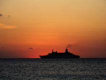 Cruise in the sunset. Silhouette of a cruiseship sailing into the setting sun Stock Image