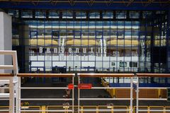 Cruise terminal external building in Bari with a wall made of mirror reflecting Costa Deliziosa. View from a ship of cruise terminal external building in Bari stock image