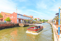 Cruise tour boat sails on the Malacca River in Malacca, Malaysia. MALACCA, MALAYSIA - AUGUST 13, 2016: Cruise tour boat sails on the Malacca River in Malacca royalty free stock images