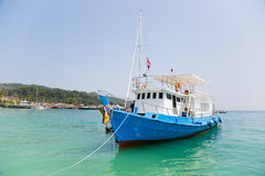 Cruise tourist boat at anchorage off the island, Thailand Stock Photos
