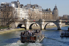 Cruise under the Pont Neuf. PARIS, FRANCE, March 12, 2015 : The Pont Neuf is the oldest standing bridge across the river Seine in Paris.It stands by the western Stock Images