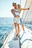 Cruise vacation. Romantic man and woman on yacht. Cruise vacation. Romantic happy men and women on yacht stock image