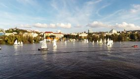 Cruise on the Vltava River in Prague,  Czech Republic,. Sailing boats   passing next to a cruise ship on the Vltava River in Prague,  Czech Republic stock footage