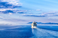 The cruise white liner floating away into the distance Stock Photos