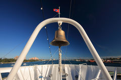 Cruise white sea's bell. Red Flag,blue sea,blue sky,white boat. Royalty Free Stock Photography