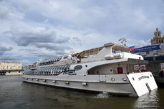 A cruise yacht sails on the Moscow river Royalty Free Stock Photo