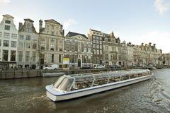 Cruiseboat in Amsterdam Netherlands. Cruiseboat cruising through Amsterdam in the Netherlands Stock Photography