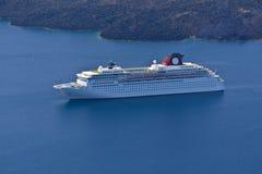 Cruiser anchored at Santorini island Stock Photos