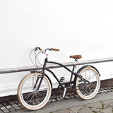 Cruiser bicycle near a white wall.  Stock Images