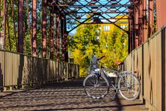 Cruiser bike on a bridge over the Boise River in downtown Boise, Idaho. Bicycle on a Boise River bridge in the royalty free stock images