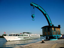 Cruiser and crane. Danube river Royalty Free Stock Photography