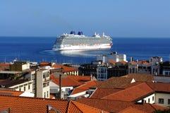 Cruiser leaving  port Stock Image
