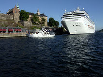 Cruiser in Oslo harbor. Picture of cruiser and yacht in Oslo harbor Stock Photo