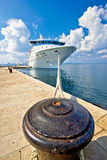 Cruiser ship tied on mooring bollard. Vertical view Stock Images