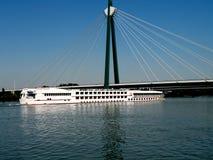 Cruiser under bridge Royalty Free Stock Images