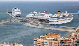 Cruisers in the harbor of Malaga, Spain. Malaga is located in southern Spain, on the Costa del Sol (Coast of the Sun) on the northern side of the Mediterranean Royalty Free Stock Photography