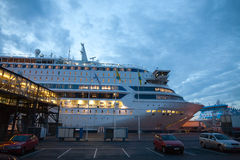 Cruises. In the evening, the cruise ship moored at the pier Royalty Free Stock Photo