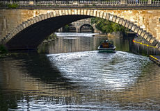 Cruises on the River Avon at Bath. Boat going under a Bridge Crossing the River Avon at Bath Royalty Free Stock Images