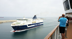Cruises sailing near a port Royalty Free Stock Photo