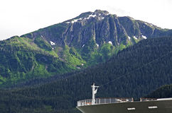 Cruiseship bow with mountain Stock Photography