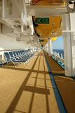 Cruiseship detail. Deck of cruiseship showing blue deckchairs and yellow lifeboats Royalty Free Stock Photo