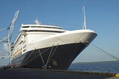 Cruiseship docked in harbor Stock Photo