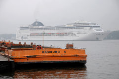 Cruiseship leaving port of Hamburg Stock Photography