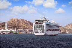 Cruiseship Ventura leaving the port of Alicante with the pilot cutter boat. View of large cruise ship Ventura of P&O company maneuvering for leave the port of Royalty Free Stock Photography