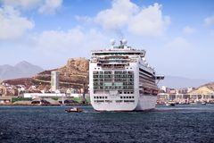 Cruiseship Ventura leaving the port of Alicante with the pilot cutter boat. View of large cruise ship Ventura of P&O company maneuvering for leave the port of Royalty Free Stock Photos