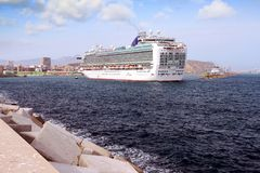 Cruiseship Ventura leaving the port of Alicante with the pilot cutter boat. View of large cruise ship Ventura of P&O company maneuvering for leave the port of Royalty Free Stock Images