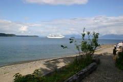 Cruising Alaska. A cruise ship off a small island in Alaska Royalty Free Stock Photography