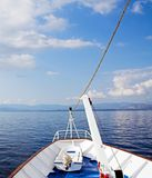 Cruising the blue sea and sky Stock Images