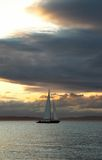 Cruising boat at sunset. With a dramatic clouds Royalty Free Stock Images