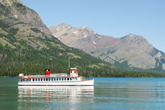 Cruising boat on waterton lake Royalty Free Stock Photo