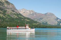 Cruising boat on waterton lake royalty free stock photo
