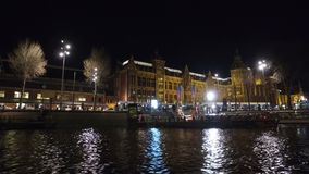 Cruising on the canals in Amsterdam Netherlands at sunset stock video