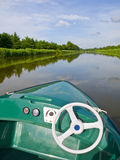 Cruising in Chambord. This is an electrical boat you can rent in the canals of Chambord, where you can see awesome views of the castle Royalty Free Stock Photo