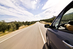 Cruising the countryside. In a blue car at high speed stock image