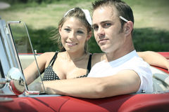 Cruising Couple. A retro looking American couple cruising in a vintage convertible car stock photos
