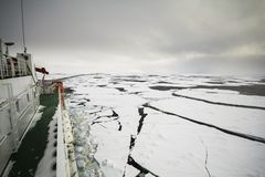 Cruising in frozen ocean. Research icebreaker cruising in frozen ocean  by breaking ice at polar seas Royalty Free Stock Image