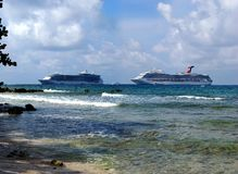 Cruising in Grand Cayman. Panoramic view of two cruise liners from Seven Mile Beach on Grand Cayman Island, British Virgin Islands Stock Photos