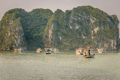 Cruising in Halong Bay, Vietnam. Ha Long Bay, in the Gulf of Tonkin, includes some 1,600 islands and islets, forming a spectacular seascape of limestone pillars Royalty Free Stock Photos