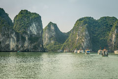 Cruising in Halong Bay, Vietnam. Ha Long Bay, in the Gulf of Tonkin, includes some 1,600 islands and islets, forming a spectacular seascape of limestone pillars Stock Photos