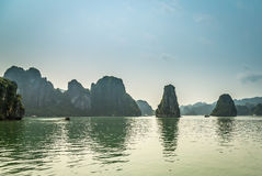 Cruising in Halong Bay, Vietnam. Ha Long Bay, in the Gulf of Tonkin, includes some 1,600 islands and islets, forming a spectacular seascape of limestone pillars Stock Image