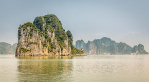 Cruising in Halong Bay, Vietnam. Ha Long Bay, in the Gulf of Tonkin, includes some 1,600 islands and islets, forming a spectacular seascape of limestone pillars Stock Photography