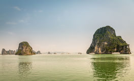 Cruising in Halong Bay, Vietnam. Ha Long Bay, in the Gulf of Tonkin, includes some 1,600 islands and islets, forming a spectacular seascape of limestone pillars Royalty Free Stock Images