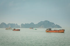Cruising in Halong Bay, Vietnam. Ha Long Bay, in the Gulf of Tonkin, includes some 1,600 islands and islets, forming a spectacular seascape of limestone pillars Royalty Free Stock Image