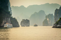 Cruising in Halong Bay, Vietnam. Ha Long Bay, in the Gulf of Tonkin, includes some 1,600 islands and islets, forming a spectacular seascape of limestone pillars Stock Images
