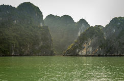 Cruising in Halong Bay, Vietnam. Ha Long Bay, in the Gulf of Tonkin, includes some 1,600 islands and islets, forming a spectacular seascape of limestone pillars Stock Photo