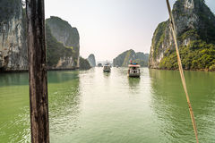 Cruising in Halong Bay, Vietnam. Ha Long Bay, in the Gulf of Tonkin, includes some 1,600 islands and islets, forming a spectacular seascape of limestone pillars Royalty Free Stock Photo